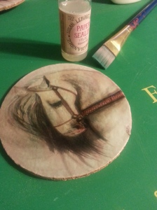 I used Susan Lenart Kazmer Paper Sealer, from Hobby Lobby, $3.99. to seal the pa