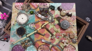 Junk jewelry layout on shadow box frame with colorful backround