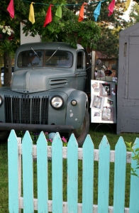 1947 Ford and aqua picket fence at flea market
