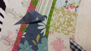 Fill in gaps with any fabric of choice. Cut overlap fabrics away.