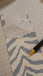Trace desired shapes on reverse side of HeatnBond ( shown on right side in this instance for best fabric pattern placement)