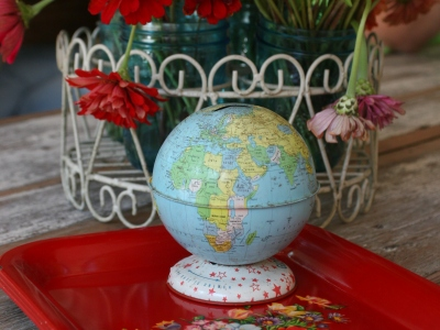 Tiny, world globe bank on red, vintage, metal trays